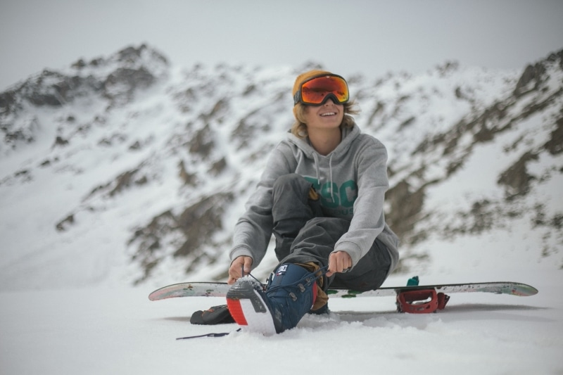 Girl sitting on a snowboard