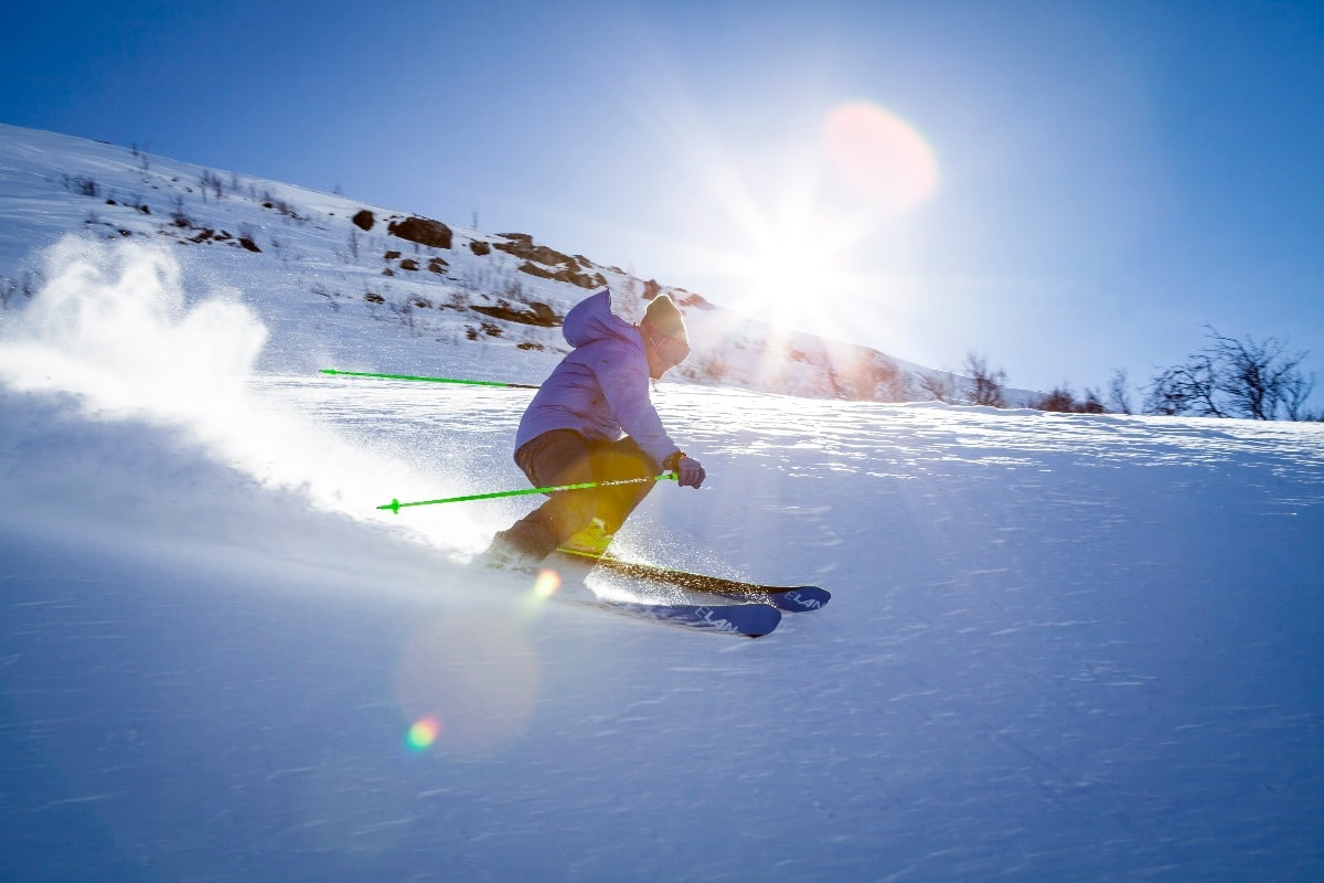 A man skiing on a sunny day